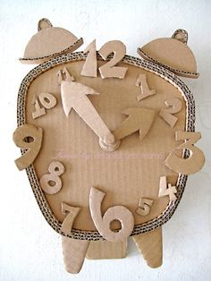 Cardboard Clock DIY Make a Cardboard Clock and let your children decorate diy ideas with cardboardEnjoy this list of creative cardboard crafts, and make your own creation. Do not worry about whether you are wasting anything, because cardboard c Cardboard Sculpture, Cardboard Toys, Cardboard Furniture, Cardboard Crafts Kids, Cardboard Playhouse, Kids Crafts, Arts And Crafts, Family Crafts, Decor Crafts