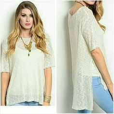 Short Sleeve High Low Tunic Sweater Trendy natural white short sleeve light and airy sweater with high low style. 75% rayon cotton, 25% polyester. Semi sheer pair this with your favorite cami or tank.  Made in the USA. Brand new from our boutique. Jill Marie Boutique Tops Tunics