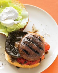 """Portobello """"burger"""" with red pepper and goat cheese, I also like to add some carmelized onions.  I could eat this every day in the summer time."""