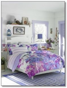 Teen Vogue Lilac Watercolor Comforter Set is a floral bedding design perfect for a teen girls bedroom. The set includes a comforter and a sham.