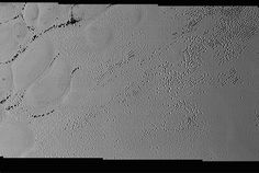 This image was taken by the Long Range Reconnaissance Imager (LORRI) on NASA's New Horizons spacecraft shortly before closest approach to Pluto on July 14, 2015; it resolves details as small as 270 yards (250 meters). The scene shown is about 130 miles (210 kilometers) across. The sun illuminates the scene from the left, and north is to the upper left.