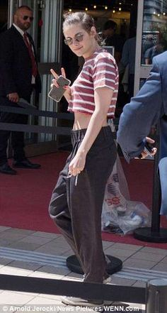 Top of the crops: Kristen slipped into a striped tee and baggy trousers as she wandered through Cannes on Tuesday