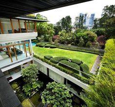 Constructed on a Singapore city lot, this amenity-laden residence is bordered on all sides by other occupied lots. To instill a sense of natural connection and open space, Guz...