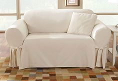 Photo of Cotton Duck One Piece Slipcovers MICHIGAN ROOM , stain resistant of course