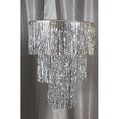The Silver Three Tier Chandelier features thousands of intricately detailed metallic mylar strands. Each of the silver tier chandeliers hangs 3 feet long. $24.99