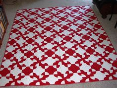 Drunken path red and white quilt. One of my favorite quilt blocks (especially in two colors).