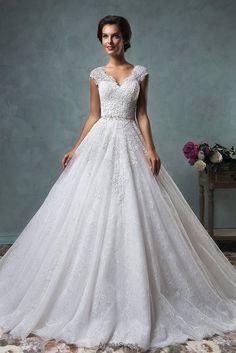 Flourishing details and embellishments really make each and every dress radiate with elegance! Dress: Amelia Sposa 2015