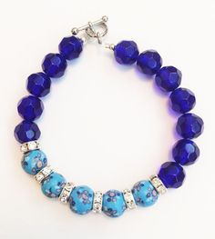 Clay and blue glass beads. $15.00.