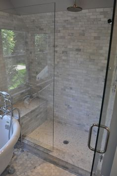Stunning glass shower design with carrara marble subway tile shower surround, marble shower bench and carrara marble hex tile shower floor. Spa-like shower features seamless glass door and polished chrome rain shower head. Subway Tile Showers, Marble Subway Tiles, Marble Showers, Hex Tile, Marble Floor, Tiled Showers, Mosaic Tiles, Decoration Inspiration, Bathroom Inspiration