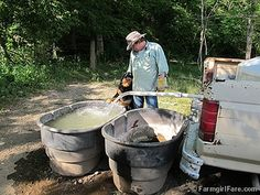 Filling water tanks in Donkeyland. One of 27 photos in the latest Friday Farm Fix on Farmgirl Fare.