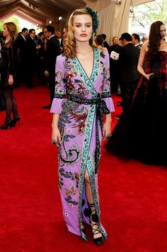 Met Gala 2015: The Best-Dressed Celebrities of the Night via @WhoWhatWear WHO: Georgia May Jagger  WEAR: Gucci custom lilac silk georgette belted floor length gown embellished with an Asian inspired multi colored motif of flowers and birds hand embroidered with silk threads, glass beads and crystals, hairpiece, jewelry, and sandals.