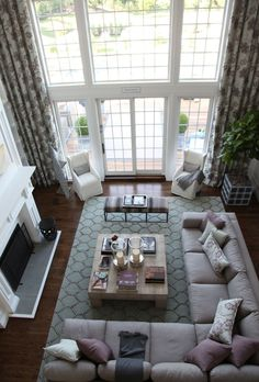 dream home - love the fireplace, sectional, huge windows, coffee table and the chairs by the windows