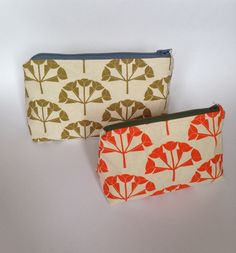Screen printed 'Hydrangea' wash bag in sage green and tangerine 🍊