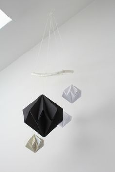 Little baby Liv loves staring at this mobile. Sometimes at nap time, I twist the cord and make it spin. It's a brilliant distraction whil. Origami Geometric Shapes, Geometric Decor, Diy Paper, Paper Art, Paper Crafts, Paper Diamond, Paper Mobile, Origami Lamp, Diy For Kids