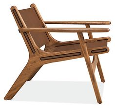Sculptural, with a modern mix of materials for a masculine, yet warm appearance, the Lars lounge chair will become the focal point of your room. Handcrafted in Vermont, the frame is built from solid wood with broad armrests and a low sit for comfortable lounging. With leather sourced from a Minnesota tannery, the seat and back are constructed by a Minnesota company known for their expertise in crafting quality leather goods. The soft curves and expert craftsmanship ensure this chair will age…