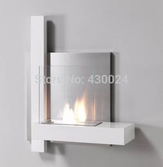 Bio ethanol fireplace wall mounted with stainless steel bio ethanol burner Bioethanol Fireplace, Stove Fireplace, Modern Fireplace, Fireplace Wall, Fireplace Design, Bio Ethanol, Wall Mount Electric Fireplace, Electric Fireplaces, Fireplace Pictures