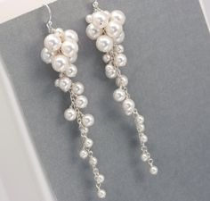 These long pearl cluster earrings are handmade with Swarovski Crystal Pearls and nickel free sterling silver. This long and elegant cascade of