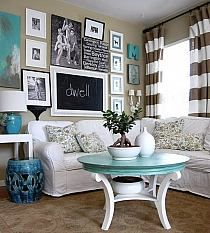 love the tan brown wall color and gray striped curtains. teal and white living room