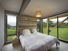 VFLA designed this rustic modern interiors with large windows that gives you the sense of the outdoors from the comfort of a bedroom.