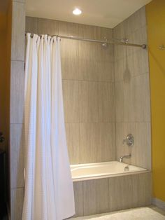Love this contemporary look- the vertical lines in the tile make the shower look twice its height. Rental Bathroom, Bathroom Ideas, Bathrooms, Shower Alcove, Bath Shower, Take Me Home, Basement, Tile, New Homes
