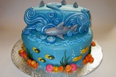 (again, I'm looking at the different ways to make waves on a cake) Ocean/Shark Cake by Cake Maniac, via Flickr