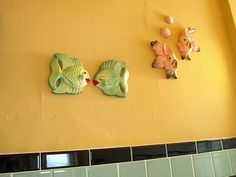 Almost every bathroom in America had these types of wall decorations back then...mostly aquatic themed.