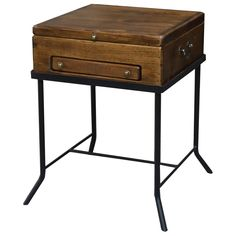 The solid pine Keepsake End Table has a lift top for storage and a small drawer for trinkets. A hand-made wrought iron base completes the table.