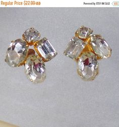 These #vintage large rhinestone earrings are unusual and so sparkly!   The large four stone earrings are prong set in gold plated metal.  Very unusual and lovely!  Clip-on c... #ecochic #etsy #jewelry #jewellery