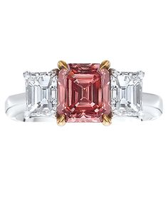 Fancy Pink Diamond Ring Natural, fancy brownish-orangy-pink emerald-cut diamond mounted with emerald-cut white diamond side stones, in a platinum and 18-karat rose gold setting. Center diamond weight: 1.75 carats. Cellini Jewelers.