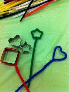Homemade bubble wands with pipe cleaners and cookie cutter shapes