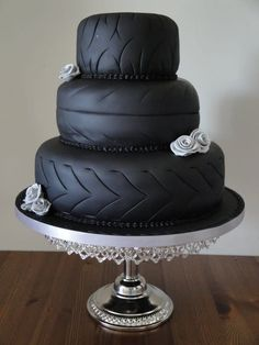Working in black is soooooooo much fun. Hard wotk but fun. Loved creating this for a biker couple who wanted traditional with a twist. Each tier made to resemble tyres