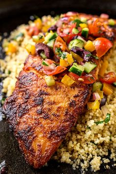 A mildly spicy salmon fillet seared to a succulent, golden-brown perfection, topped with a mediterranean salsa fresca—the perfect pan seared salmon! Salmon Dishes, Fish Dishes, Seafood Dishes, Fish And Seafood, Fish Recipes, Seafood Recipes, Cooking Recipes, Healthy Recipes, Pan Seared Salmon