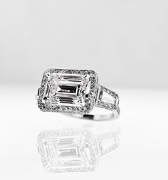 Emerald cut diamond engagement ring created from my client's delicately worn diamond.