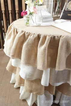 We love this ruffled burlap table skirt, rustic, elegant  and girly all at the same time.