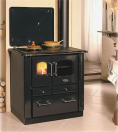 modernized Wood burning cook stove/oven, in case gas is low and power is out :)