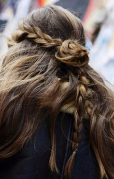 love this low key braid with bun and long wavy hair.