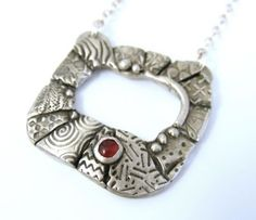 Pendant with red stone by Gloria Kelman