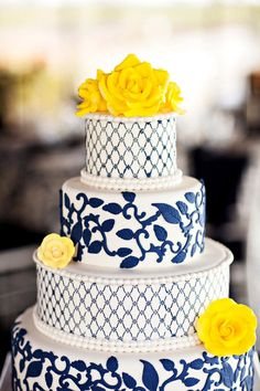 Cakes Blue Navy tiers Round cake stand pattern fondant pop of color accents Yellow sugar flowers #BridalTribe #PinParty