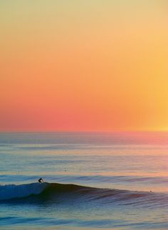 perfect ride   surfboard..the sea and sunset..