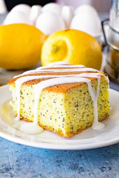 This Lemon Poppy Seed Cake starts with a box lemon cake mix and is dressed up with the addition of lemon pudding mix and a delicious lemon glaze. It's light, fluffy and delicious, plus it's easy! No one will know it started with a box mix. Lemon Loaf Cake, Lemon And Coconut Cake, Lemon Cake Mixes, Lemon Icing, Delicious Cake Recipes, Cake Mix Recipes, Yummy Cakes, Dessert Recipes, Lemon Desserts