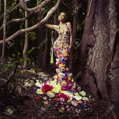 17625971-Blooming-gorgeous-lady-in-a-dress-of-flowers-in-the-rainforest-Stock-Photo.jpg (1300×1300)