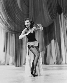 """Full shot of Ann Miller as Nadine Hale singing and dancing during musical numbrer """"Shaking' The Blues Away."""""""