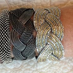 Two Silver cuff bracelets Fashion silver braided cuff braceletsthe heavier one of the two one is multi toned the other looks like vintage silver but has no marks  you can buy one for 15. whichever one you like or take both for 25. Jewelry