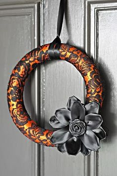 I like this idea for a Fall wreath, but maybe brown lace fabric instead of black.