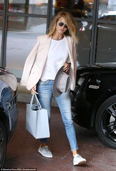Making basics brilliant: Rosie Huntington-Whiteley looked rather lovely as she emerged from a building on Thursday while in London