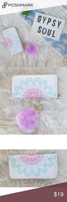 "Ombre Mandala Wallet & Faux Fur Pom Keychain Beautiful wallet with image of a pink, blue, and purple ombre mandala paired with a violet faux fur pom keychain. This set is the perfect accessory for summer. New without tags.  This fashion wallet is made of man made materials as is the keychain.   Wallet Measurements  3.75in × 7.5in  8 card slots   *please note these items are considered ""costume accessories"". Bags Wallets"
