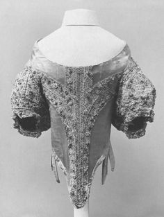 This bodice trimmed with parchment lace is a rare example of late 17th century women's dress in the V collections. Typical of 1660s fashion are the long waist, off-the-shoulder neckline and short, full, cartridge-pleated sleeves.V Search the Collections