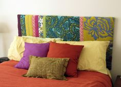 This is a great idea to make your own headboard!  You can use an old blanket or cool fabric.
