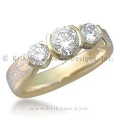 Mokume Three Stone Engagement Ring, Tapered, Round and Rounds - This handmade mokume gane engagement ring has three round diamonds atop a tapered band.