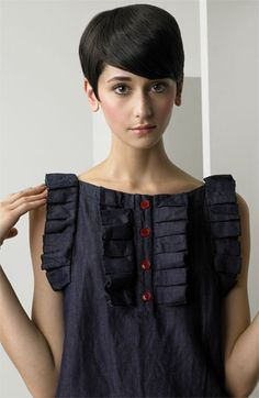 See by Chloé Ruffle Trim Denim Dress. This model is the cutest thing ever.